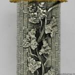 Cocherel; portagrissini in argento sbalzato e cesellato; tetto e galletto segnavento dorati